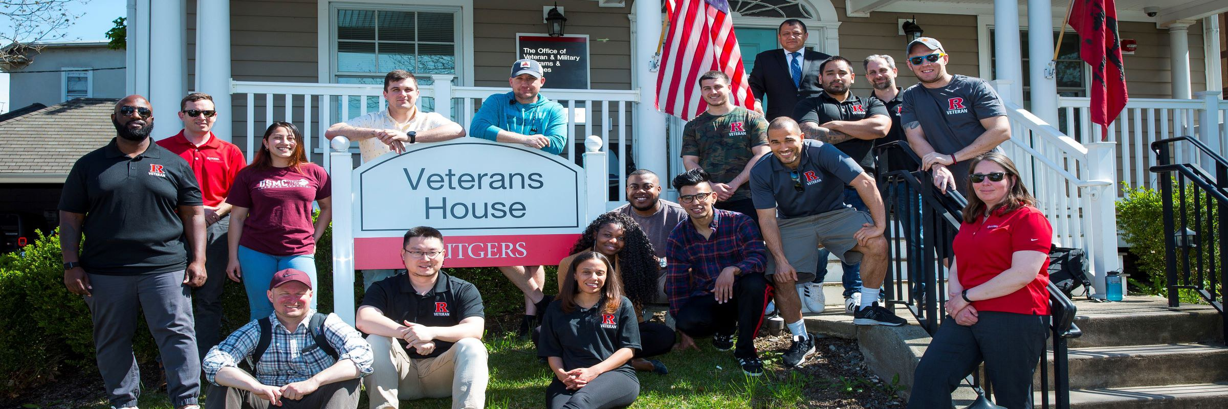 Photo of Students and Staff in front of Veterans House