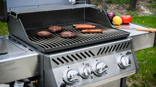 Grill with hot dogs and hamburgers